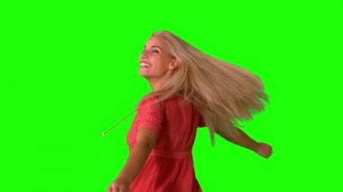 Attractive blonde twirling on green screen — Stock Video