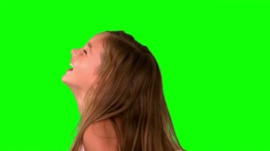 Close up of little girl laughing and turning on green screen — Stock Video