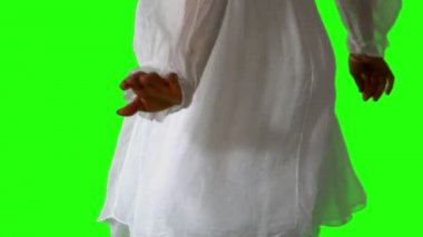 Girl in white dress turning on green screen close up — Stock Video