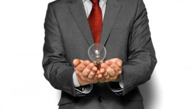 Man throwing light bulb — Stock Video