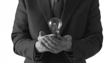 Man tossing a light bulb — Stock Video