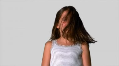 Little girl shaking her hair on white background — Stock Video