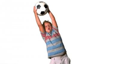 Boy catching football on white background — Stock Video