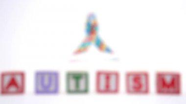 Autism blocks and ribbon — Stock Video