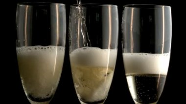 Three champagne flutes — Stock Video