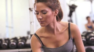 Woman lifting dumbbell — Стоковое видео