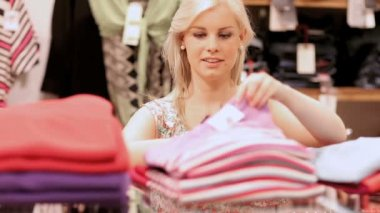 Woman folding clothes and smiling — Stock Video