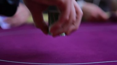 Man placing chips on table and others throwing cards down — Stock Video