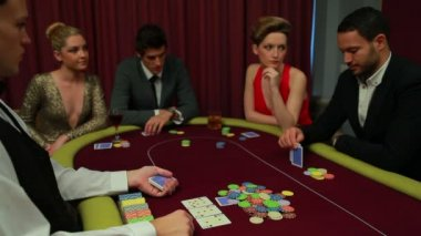 Four playing poker and one going all in — Stock Video