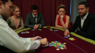 Dealer placing cards on poker table