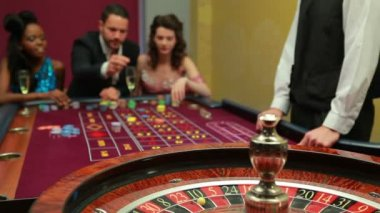 Man placing bet for rolulette in casino