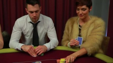 Man and woman only left in poker game and woman winning — Stock Video