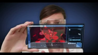 Scientist scrolling through videos of human body interior — Vídeo stock