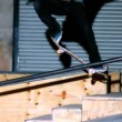 Stock Video: Skater doing crook slide down rail