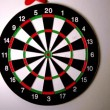 Dart hitting dart board — Stok Video #25682499