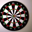 Dart hitting bulls eye on dart board — Vídeo Stock #25683587