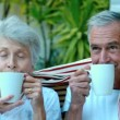 Retired couple enjoying coffee outside — Stock Video