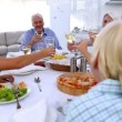 Family toasting at dinner table — Stock Video