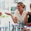 Businesswoman gesturing in front of colleagues — Stock Video
