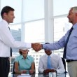 Businessmen shaking hands in the meeting room — Vídeo Stock