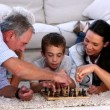 Stock Video: Extended family playing chess