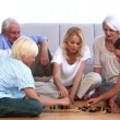 Stock Video: Family playing chess at home