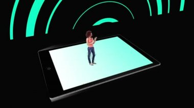 Girl walking on and using tablet pc with holographic application icons on black background — Stock Video