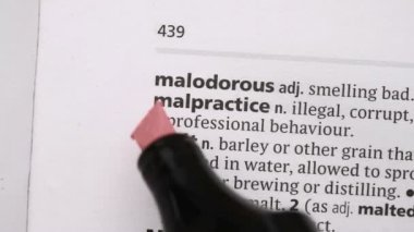 Malpractice highlighted in pink — Vídeo Stock