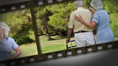 Filmstrip of elderly couple in a park — Stock Video