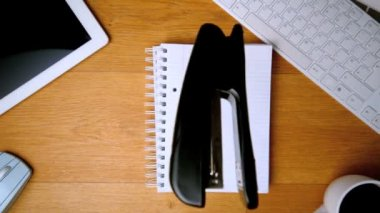 Stapler landing on notepad on office desk — Stock Video