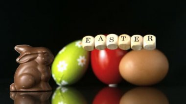 Dice spelling out easter falling in front of easter treats and egg — Stock Video