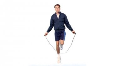 Young man training with a skipping rope — Stock Video