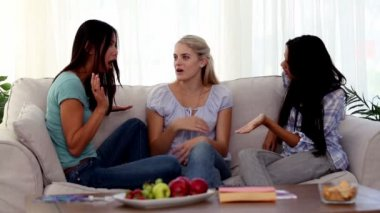 Excited woman gesturing while discussing with friends — Stock Video