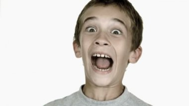 Boy grimacing against white background — Stock Video