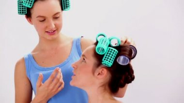 Girls in hair rollers and pajamas chatting — Stock Video