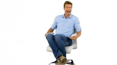 Smiling man turning on swivel chair on white background — Stock Video