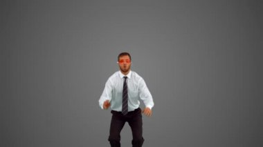 Businessman wearing swimming goggles jumping on grey background — 图库视频影像
