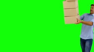 Clumsy man dropping boxes down on green screen — Stock Video