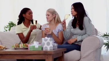 Attractive friends clinking their flutes of champagne — Stock Video