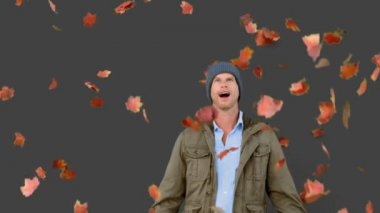 Amazed man looking at falling leaves on grey screen — Stock Video