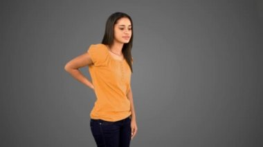 Woman rubbing painful back on grey background — Video Stock