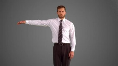 Businessman body popping on grey background — Stock Video