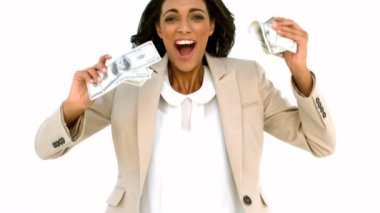 Cheerful businesswoman holding dollars and jumping — Stock Video