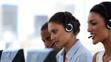 Call centre agents working in their office — Stock Video