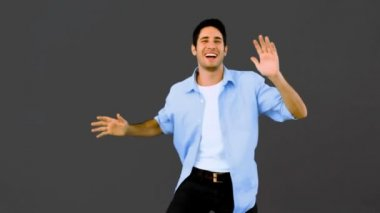Man dancing and having fun on grey background — Stock Video