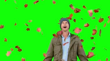 Amazed man looking at falling leaves on green screen — Stock Video