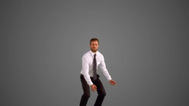 Businessman leaping on grey background — Stock Video