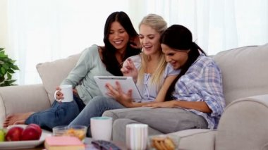 Attractive friends having fun with a tablet pc — Stock Video