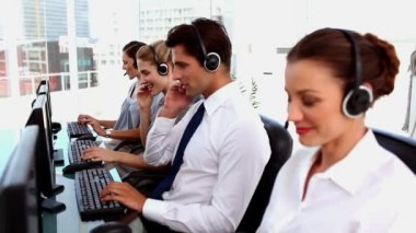 Smiling call centre agents with headset — Stock Video