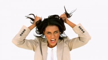 Stressed businesswoman shaking her hair — Stock Video